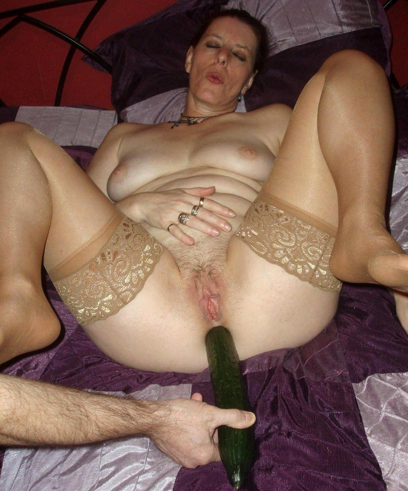 bare housewife with huge cucumber..